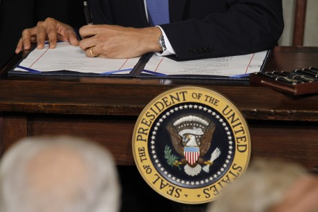 U.S. President Obama signs the healthcare legislation at the White House in Washington