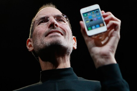 Apple CEO Steve Jobs holds the new iPhone 4 at the Apple Worldwide Developers Conference in San Francisco on Monday.