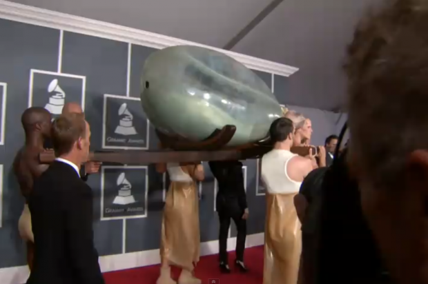 Lady Gaga enters the Grammys in an egg