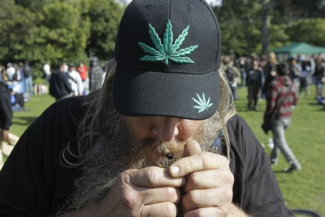 A man smokes marijuana at Golden Gate Park in San Francisco, Tuesday, ...