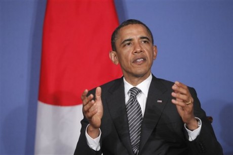 Obama, in Europe, signs Patriot Act extension