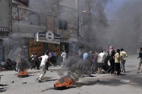 Supporters of Yemen's government controlled part of a street in Sana, the capital, during a clash with antigovernment protesters.
