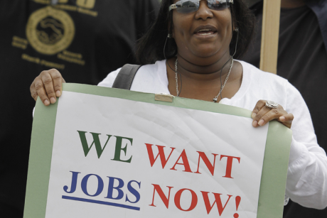 Unemployed Deanna Rice holds up a sign at a workers rally in San Francisco, Thursday, Sept. 16, 2010.