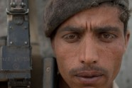 Facing dust-loaded dry winds, Afghan Border Police officer Masoud Sayed watches for signs of trouble along the Durand Line in Nangarhar province
