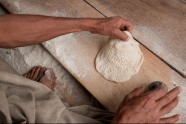 Steeped in flour, a skillful hand stamps patterns into bread bound for Afghan Border Police in Goshta district, Nangarhar province