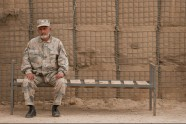 On wood slats, an Afghan Border Police officer takes a load off his leather loafers in Goshta district, Nangarhar province, on April 15.