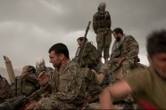 Caught outside in bad weather, a kilometer long Afghan National Security Forces convoy is hit by a cloudburst while returning from a successful opium poppy eradication operation in Goshta district, Nangarhar province