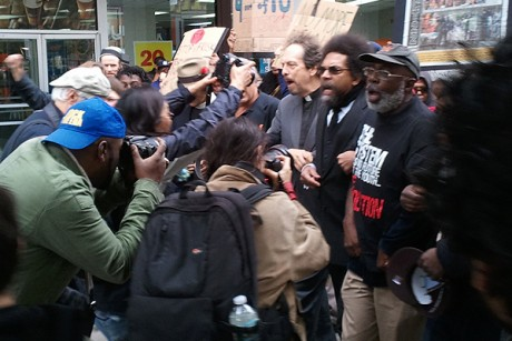 "Cornel West marches down 125th Street in Harlem on Friday in protest of the NYPD's ""stop and frisk"" policy."
