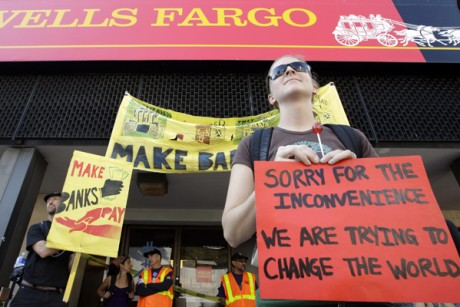 Occupy Oakland protesters stand outside of a Wells Fargo bank in Oakland