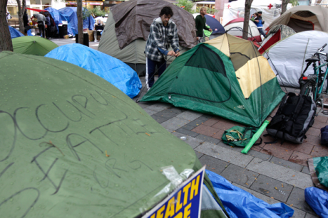 A homeless man sets up a tent at Occupy Seattle on Oct. 5, 2011