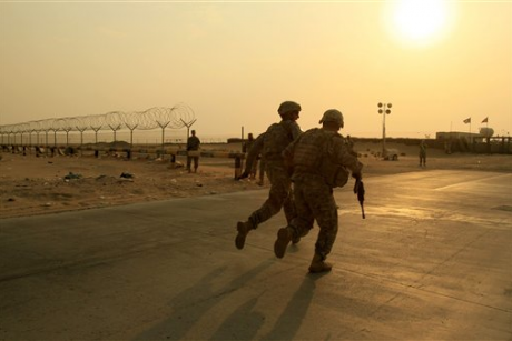 U.S. Army soldiers race toward the border from Iraq into Kuwait on Wednesday, Aug. 18, 2010.