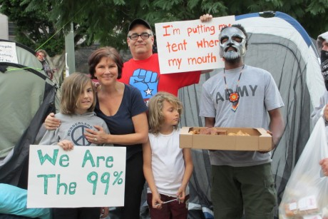 A photo of the author with her family and an Occupy Los Angeles protester