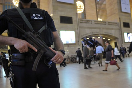 An armed Metropolitan Transportation Authority police officer stands guard in New York's Grand Central Station on Monday, May 2, 2011.