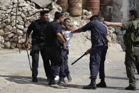 An Israeli soldier gestures
