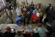 Caucus goers arrive and sign in for the 2012 Iowa Caucus