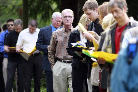 People wait in line at the 2011 Maximum Connections Job and Career Fair Thursday, Sept. 15, 2011, in Portland, Ore.