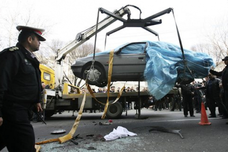 In this photo provided by the semi-official Fars News Agency, people gather around a bombed car in Tehran, Iran, Wednesday, Jan. 11, 2012