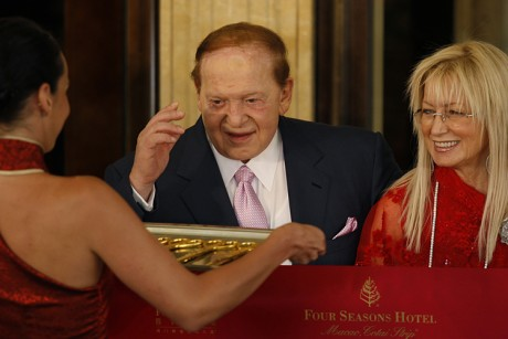 Adelson and his wife Miriam