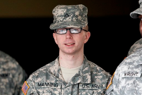 FILE - In this file photo taken Dec. 22, 2011, Army Pfc. Bradley Manning is escorted from a courthouse in Fort Meade, Md.