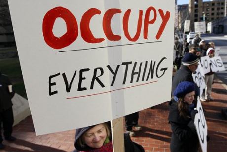 People protest against spending in federal elections in front of the U.S. District Courthouse in Baltimore, Friday, Jan. 20, 2012