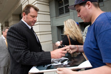 Roger Clemens signs autographs as he leaves federal court on June 5.