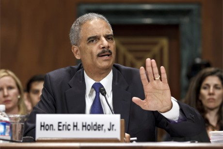 Eric Holder in a blue dress