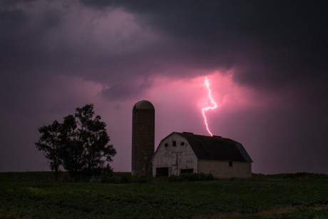 Lighting strikes over a barn surrounded by a soybean crop in Donnellson, Iowa, on July 13.