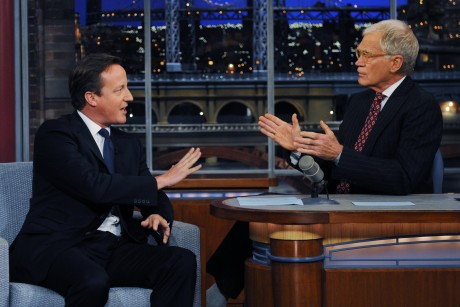 Britain's Prime Minister David Cameron talks with talk show host David Letterman on the David Letterman Show in New York, Wednesday, Sept. 26, 2012. (AP Photo / Stefan Rousseau/PA)