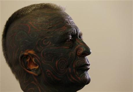 Artist with completely tattooed face runs for Czech president