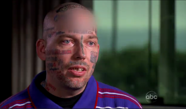 Man turns face into tattoo billboard for Internet porn sites, regrets it