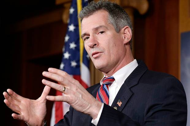 Scott Brown makes it official with Wall Street
