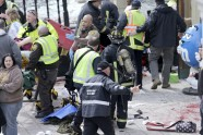 Medical workers aid injured people at the finish line of the 2013 Boston Marathon following an explosion in Boston, Monday, April 15, 2013.
