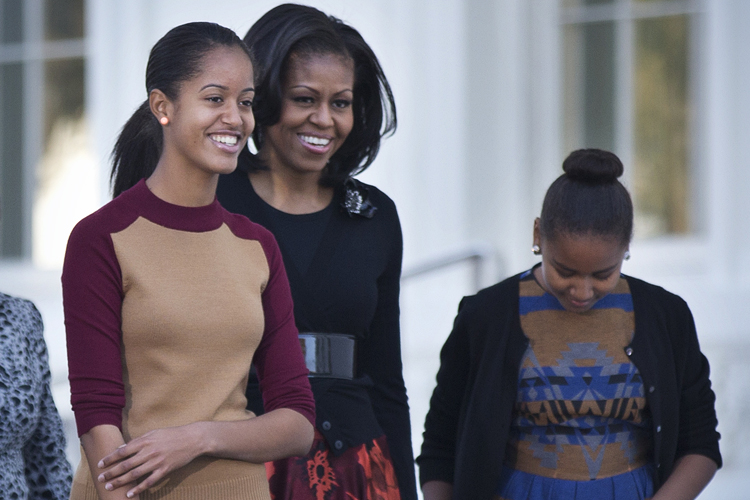 Michelle obama with daughters sasha and malia credit ap manuel