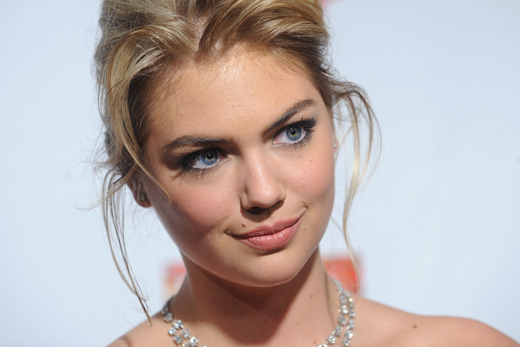 Model Kate Upton attends the 2013 Sports Illustrated Swimsuit issue ...
