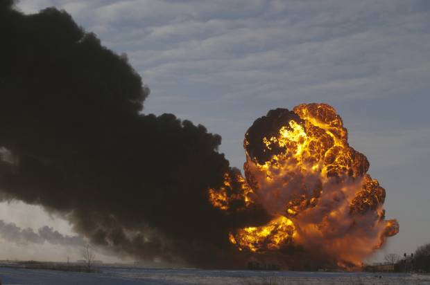 This Dec. 30, 2013 file photo shows a fireball going up at the site of an oil train derailment in Casselton, N.D. (AP Photo/Bruce Crummy, File)