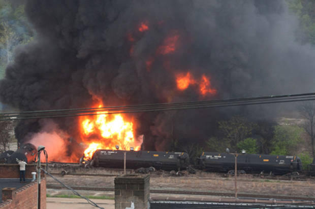 Several CSX tanker cars carrying crude oil in flames after derailing in downtown Lynchburg, Va., Wednesday, April 30, 2014. (Credit: AP/Luann Hunt)