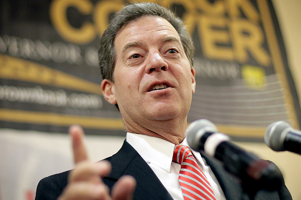 Sam Brownback is sorry he predicted his tax cuts would ...