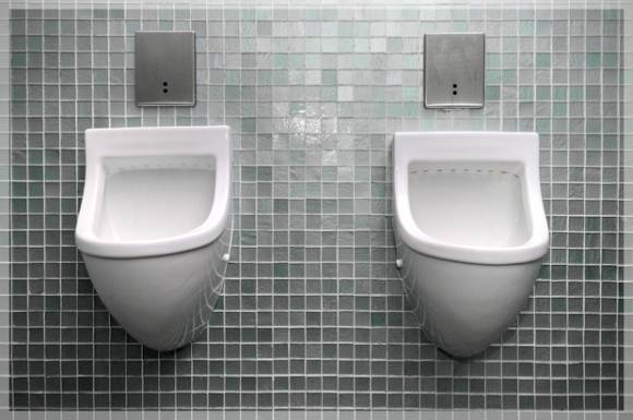 urinal stall when men are afraid to pee the bizarre scientific reason why