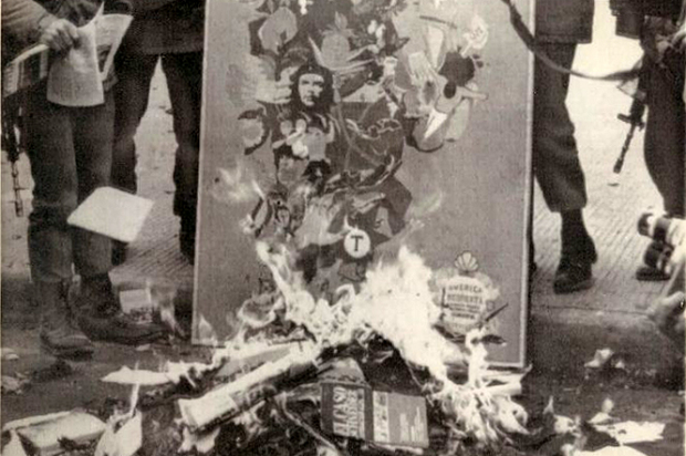 Pinochet's soldiers burning left-wing books after the 1973 U.S.-backed coup in Chile (Credit: CIA FOIA/Weekly Review)