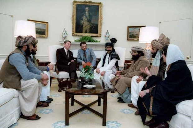 President Reagan meeting with the Afghan Mujahideen in the Oval Office in 1983 (Credit: U.S. government)
