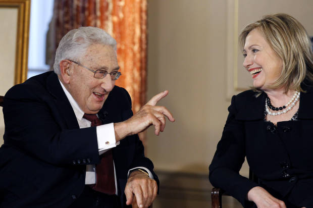 Former Secretary of State Henry Kissinger and Secretary of State Hillary Rodham Clinton talk during an interview by PBS' Charlie Rose(Credit: Associated Press)