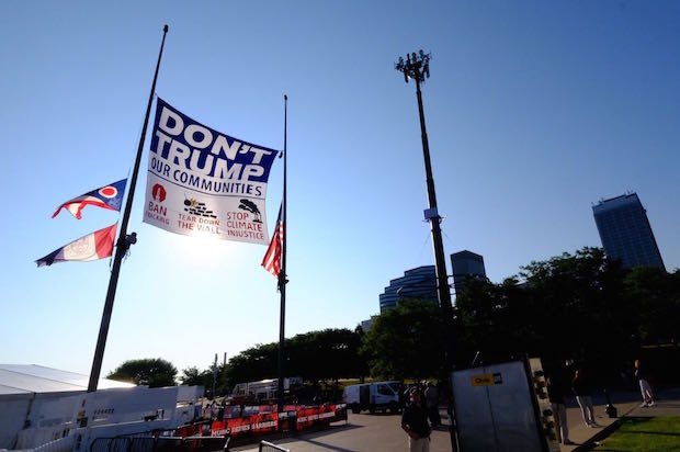 350.org protesters scaling flagpoles during the RNC (Credit: Robby Diesu)
