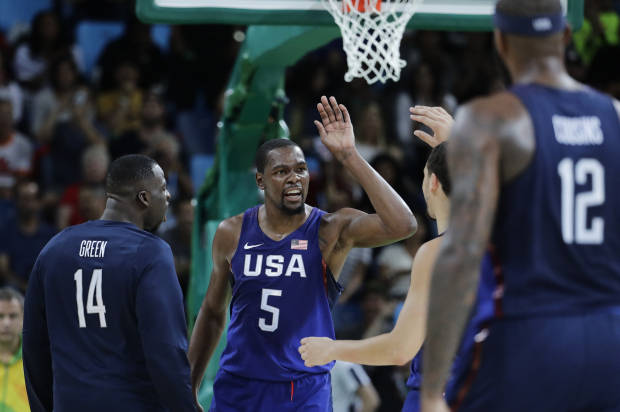 US routs Serbia for third straight gold