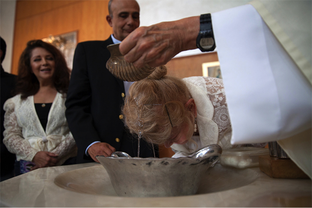 Samantha is accompanied to her baptism by her close friend Abril Campillo and her godfather Arturo Coste at the 'Sagrada Familia church' in Mexico City.