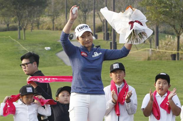 Lang leaps ahead in Korea, Park closes in