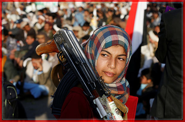 A girl carries a rifle as she attends a rally by followers of the Shi'ite Houthi movement commemorating the death of Imam Zaid bin Ali in Sanaa, Yemen