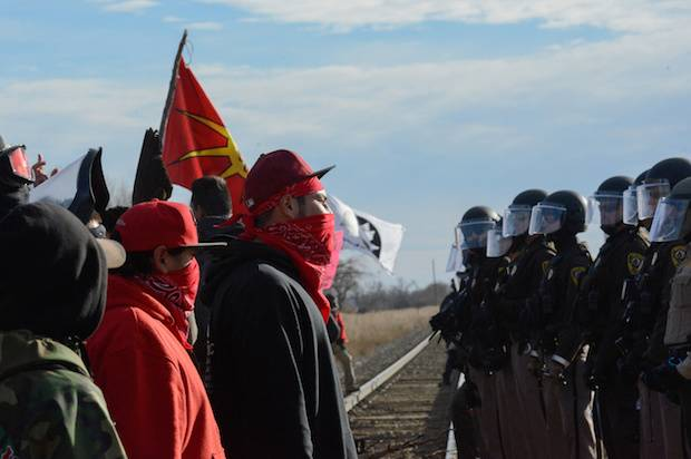 Protesters face off with police during a protest in Mandan against plans to pass the Dakota Access pipeline near the Standing Rock Indian Reservation, North Dakota