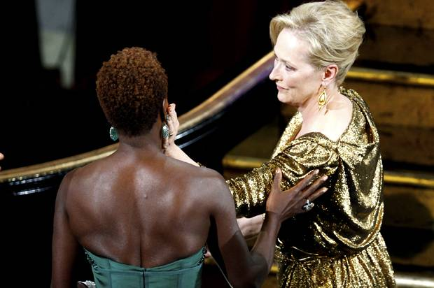 "Streep, winner of the Oscar for best actress for her role in ""The Iron Lady"" is congratulated by fellow nominee Davis at the 84th Academy Awards in Hollywood"