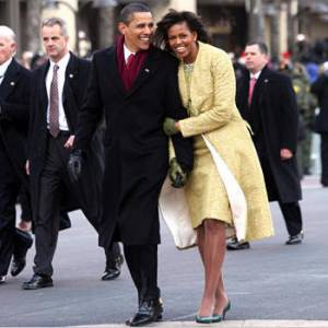 Former President and Mrs. Obama walking down Pennsylvania Avenue after his inauguration