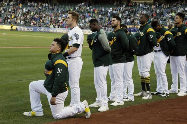 MLB joins the protests: Oakland A's player first to take a knee in baseball